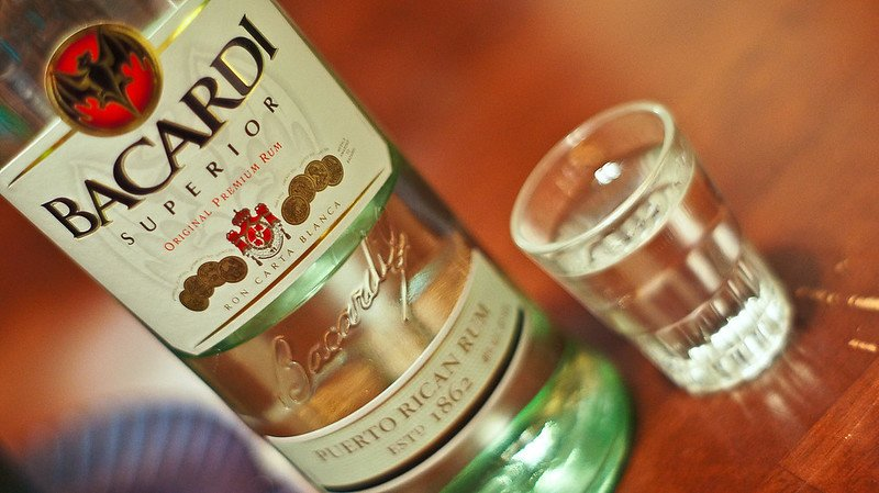 Bacardi Superior in a bottle and shot glass