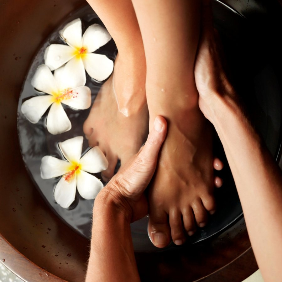 Feet in water with flowers, pedicure