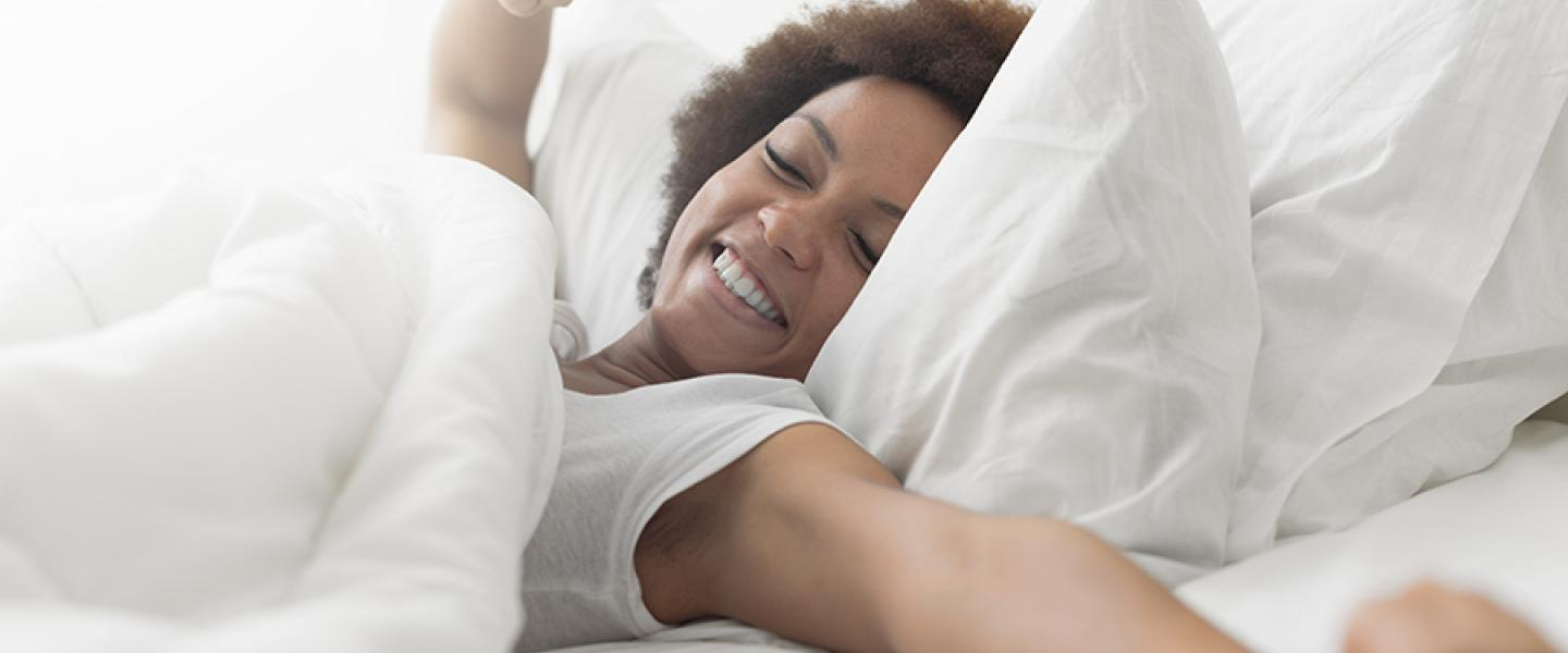 mattress topper Kenya: Woman waking up from sleep