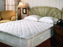A sleeping mattress with mattress pad