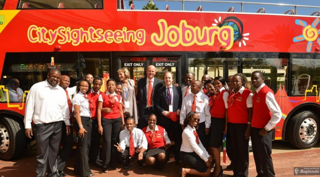 City Sightseeing Joburg bus with staff