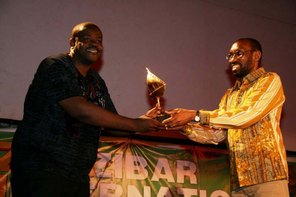 Dr. Martin Mhando (right) presents Best Actor Award at ZIFF 2011
