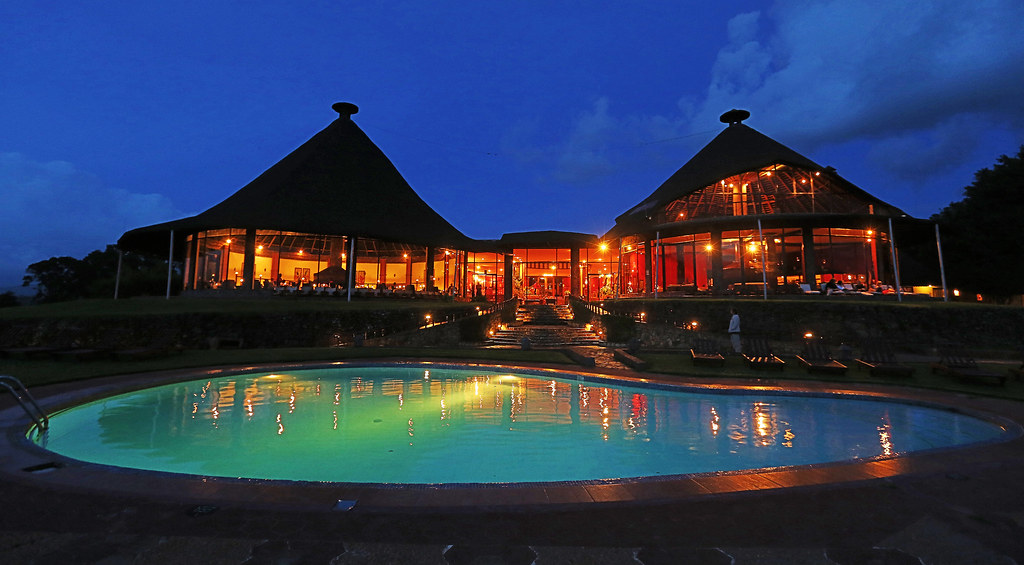 Ngorongoro Sopa Lodge Images -- the pool and restaurant by night