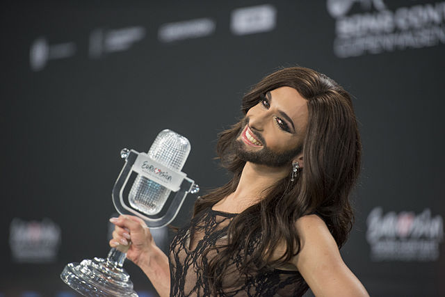 A bearded man in a dress at Eurovision